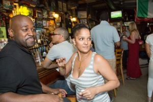 Bronxites meet and mingle over a class of Bronx Cheer, sharing the experience of the daily struggle to get buy and get ahead in New York.