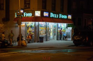 The corner, the stoop, a park-bench... The corner stores of the Bronx are a place to meet and commiserate, to enjoy the fresh air and escape the humidity.  The deli is always a place to catch up on all of the neighborhood news and not just from the newspapers.