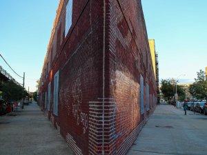 Corner building, under the El, Bronx