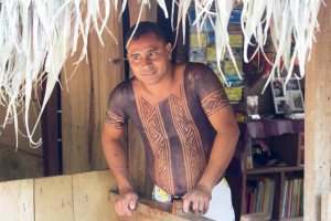 This is one of the teachers whom is provided by the government.  He dresses and lives like the Embera.